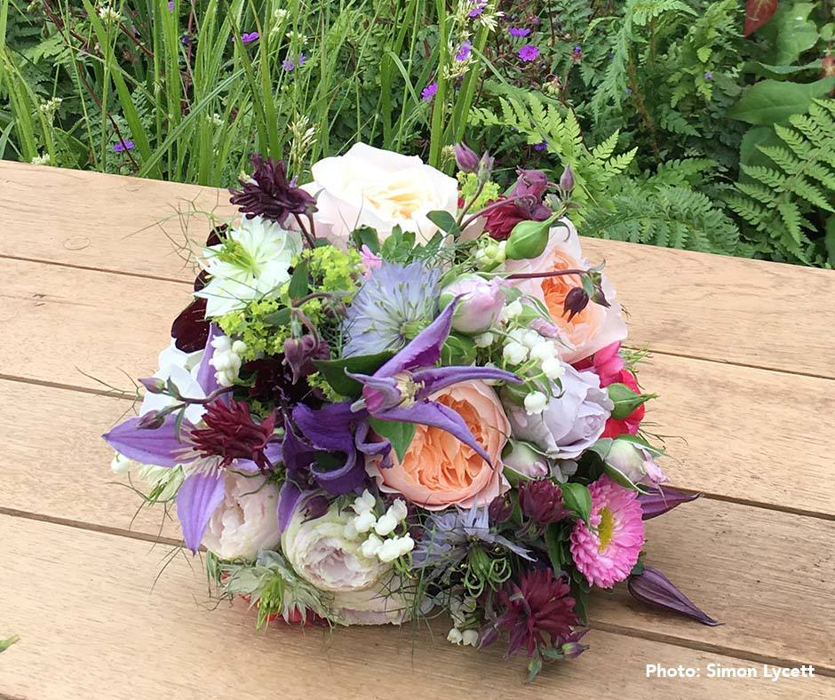 The arrangement for the queen with the clematis in it