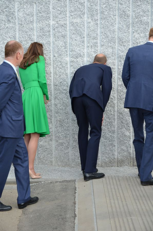 Harry William and kate looking thru to the secret wall garden