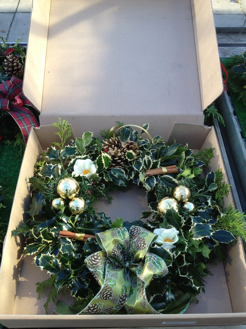 holly wreath in the mail order box