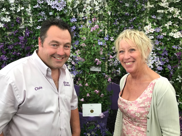 Carol and Chris, with the clematis 'Carol Klein'