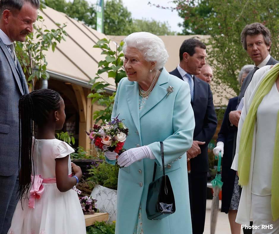 The Queen, with clematis in her arrangement
