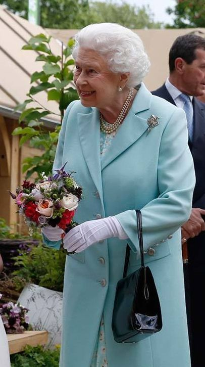 The Queen with her clematis in her bouquet